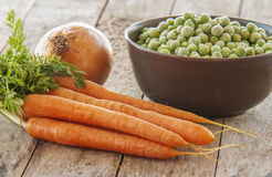 Frozen green peas with carrots Stock Photos
