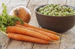 Frozen green peas with carrots Stock Photos
