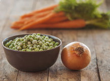 Frozen green peas with carrots Stock Photography