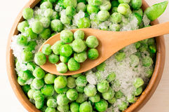 Frozen green peas Stock Images