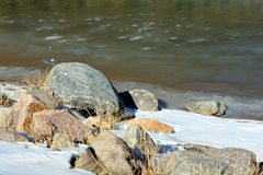 Frozen green river and rocks Royalty Free Stock Photo