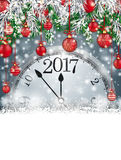 Frozen Green Twigs Christmas Baubles Snowflakes Clock 2017. Christmas card with snowflakes, twigs, baubles clock and date 2017 on the gray background Stock Image