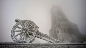 Frozen gun. With Shipka Monument in Bulgaria royalty free stock photography