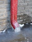 Frozen Gutter, Downspout. Gutter Pipe, Downspouts, House Foundation Wall Sometimes Freeze into Solid Blocks of Ice. Bad rain. Frozen Gutter, Downspout. Gutter stock photography