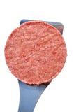 Frozen Hamburger Patty on a Spatula Royalty Free Stock Photo