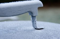 Frozen handle of iron BBQ grill Stock Image