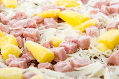 Frozen Hawaiian Pizza. Closeup of a frozen hawaiian pizza with pineapple and ham Royalty Free Stock Image