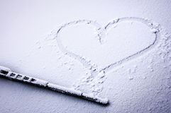 Frozen heart. Frozen windshield with heart - nice background Stock Photography
