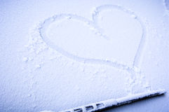 Frozen heart Stock Images