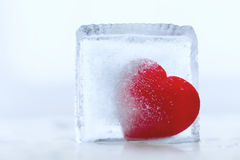 Frozen heart. In a piece of ice Stock Photo