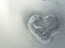 Frozen heart in the frosty window Stock Image