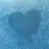 Frozen heart. Frozen glass. Ice flowers. Valentines day. Window frost. Winter window. Frozen window. Craquelure. Stock Images