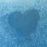 Frozen heart. Frozen glass. Ice flowers. Valentines day. Window frost. Winter window. Frozen window. Craquelure. Stock Images