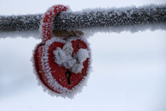 Frozen heart-shaped lock as a love symbol Royalty Free Stock Photos