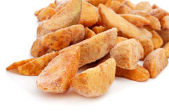 Frozen home fries. A pile of frozen home fries on a white background ready to fry Royalty Free Stock Photo