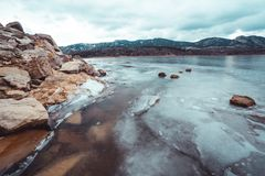 Frozen Horsetooth reservoir edge in Colorado stock photo