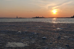 Frozen Hudson River under NYC Sunset. Sunset over frozen waters between NJ and NYC Stock Photo