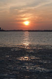 Frozen Hudson River under NYC Sunset. Sunset over frozen waters between NJ and NYC Royalty Free Stock Photography