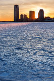 Frozen Hudson River, wood pilings and Jersey City Skyscrapers at Royalty Free Stock Photos