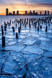 Frozen Hudson River, wood pilings and Jersey CitySkyscrapers at Stock Images