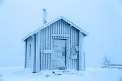 Frozen hut. Hut covered with frost, standing on top of a mountain. Finnish Lapland Royalty Free Stock Image
