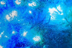 Frozen ice background with blue colour below Royalty Free Stock Images
