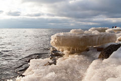 Frozen ice blocks in the sea. In winter Stock Image