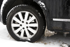 Frozen ice on car tires Stock Photo