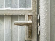 Frozen and ice covered. Door handle. Very cold winter weather Stock Photo