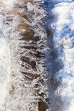 Frozen ice crystals under melting snow stream Stock Photos