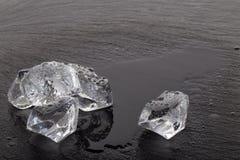 Frozen ice cubes on black slate board Stock Photo