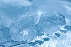 Frozen ice cubes gems. abstract crystal blue background. macro view, soft focus Royalty Free Stock Photography