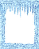 Frozen ice and icicles frame. Winter design element on a blank white background representing the cold arctic weather and low freezing  temperatures resulting in Royalty Free Stock Photography