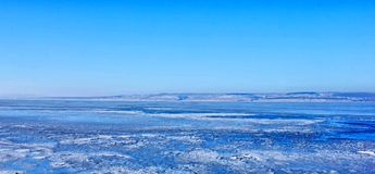 Frozen ice lake winter winter landscape blue sky Royalty Free Stock Photo