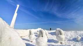 Frozen ice ocean coast - alone man polar winter Stock Photos