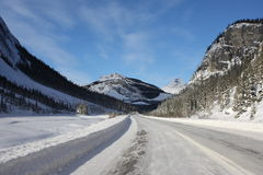 Frozen ice road in front of a mountain Royalty Free Stock Images