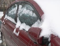 Frozen iced car windows covered with snow royalty free stock images