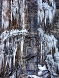 Frozen icicles landscape on granite mountain Stock Photos