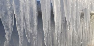 The frozen icicles of sea water. Icy handrails of the embankment in Odessa, Ukraine. cold icicle of winter sea. Winter landscape with icy fence on the background stock photography