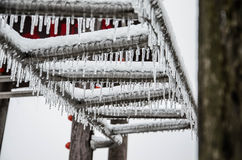Frozen icicles. On an stealladder on a public playground after ice-rain Stock Photo