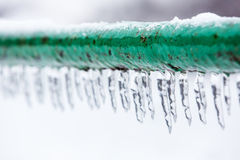Frozen icy down pipe. Icicles Royalty Free Stock Photos