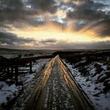 Frozen icy road. West Yorkshire north England United Kingdom winter scene sun setting creating interesting light and mood stock photography