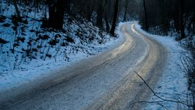 Frozen icy road in winter forest Royalty Free Stock Images