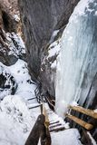 Frozen icy waterfall over ladder in gorge Baerenschuetzklamm in. Frozen icy snow covered waterfall over wodden ladder in gorge Baerenschuetzklamm near Mixnitz in Stock Images