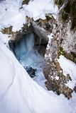 Frozen icy waterfall in snow covered gorge Baerenschuetzklamm in. Winter near town Mixnitz in Styria, Austria Royalty Free Stock Photography