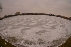 Frozen IOR lake in winter with a fisheye lens. Royalty Free Stock Photo