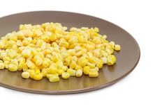 Frozen kernels of sweet corn on the brown dish closeup Royalty Free Stock Image