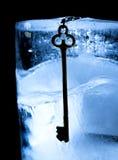 Frozen key in ice Stock Photo