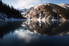 Frozen Kolsay lake in Tien-Shan mountains Royalty Free Stock Photography