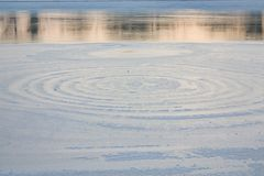 Frozen lake. Spectacular natural circles on ice with contrast of water Royalty Free Stock Photography